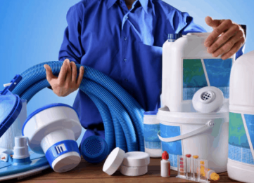 Man with pool cleaning equipment